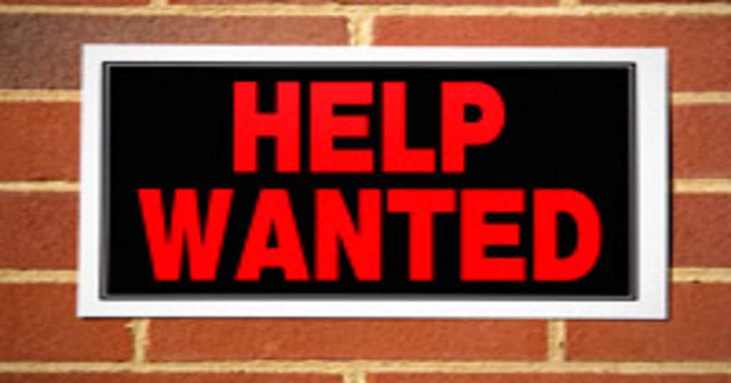 help wanted sign.brick background